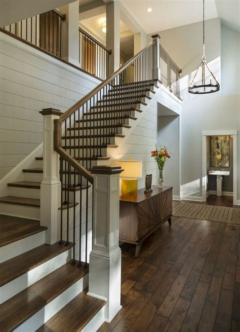 shiplap on stairs entryway with rustic wood floors l shaped stairway
