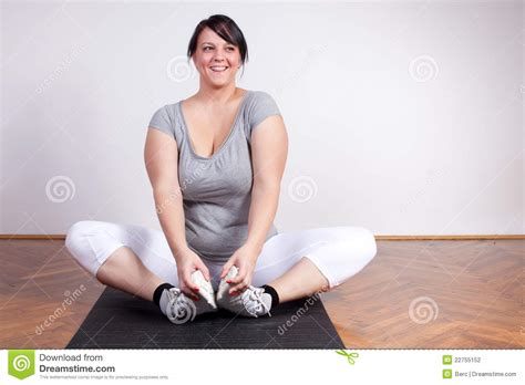 how to photograph heavy women happy overweight woman exercising stretching stock