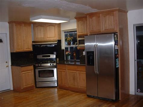 Kitchen Design With Oak Cabinets And stainless steel