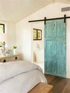 bedroom barn doors turquoise barn door on rails to bathroom cottage bedroom