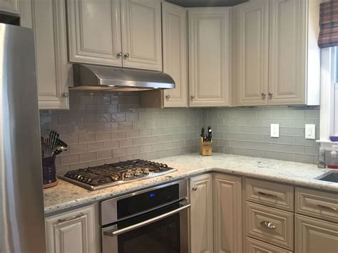 grey glass subway tile kitchen backsplash with white