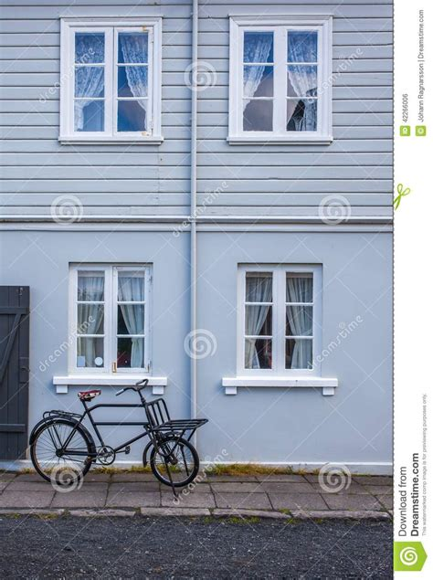 blue house with a blue window old blue house with windows and a bicycle stock photo image 42266006