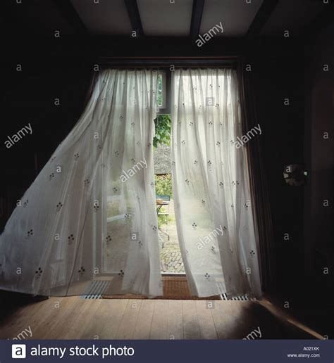 wind blowing curtains french doors with white voile curtains blowing in the wind