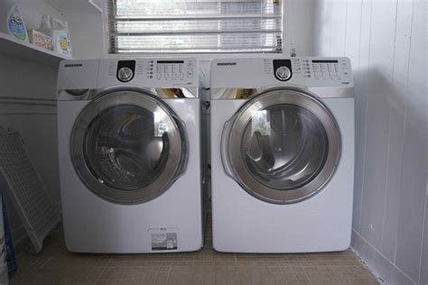 concealed washer dryer stack flickr photo sharing new washer and dryer explore roundedbygravity s photos