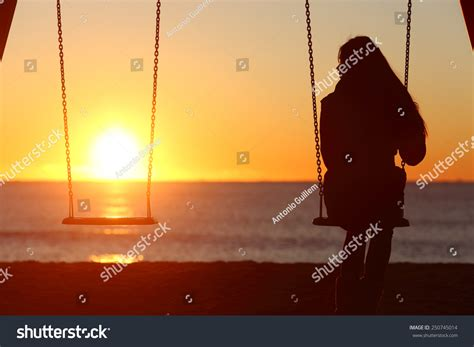looking for a cousin on a swing single woman alone swinging on beach stock photo 250745014