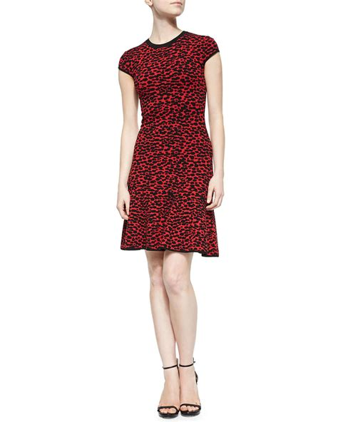 michael kors knit dress lyst michael kors spotted stretch knit flounce dress in