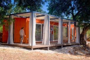 Nomad living a shipping container guest house that expands out to a
