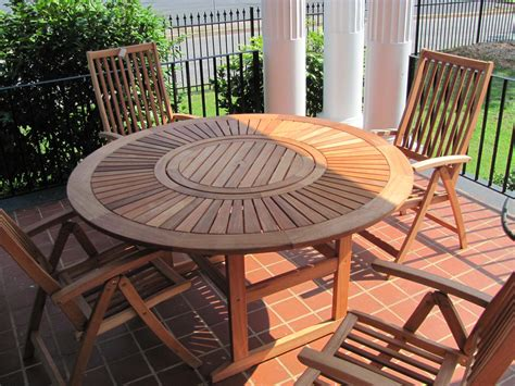 Appealing Unpolished Teak Wood Round Table Combined With Outdoor Furniture Table