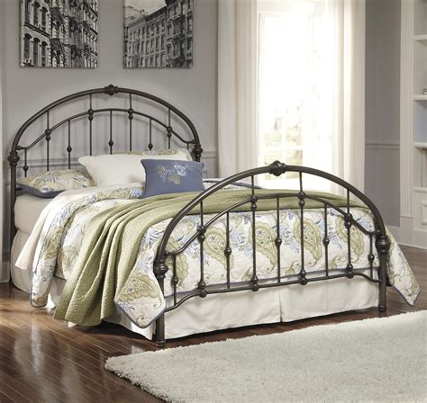 Iron And Footboards by Signature Design By Nashburg King Arched Metal Bed
