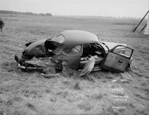 wrecked studebaker  accident scene photograph