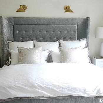 beaded headboard white and gray bedroom with beaded chandelier