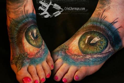 biomechanical tattoo by cris gherman realistic foot eye tattoo by chris gherman
