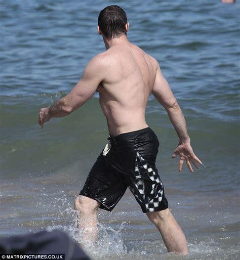 hugh jackman showcases bulging muscles   waves