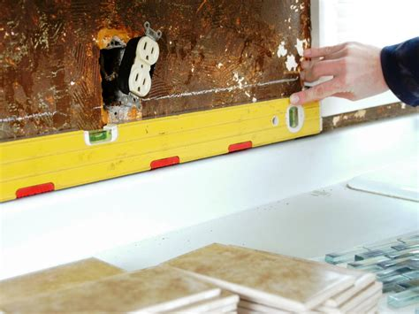 how to put up tile backsplash install a tile backsplash how tos diy