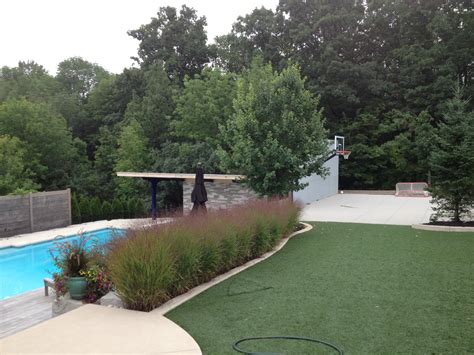 backyard pool and basketball court a backyard pool and a backyard half court