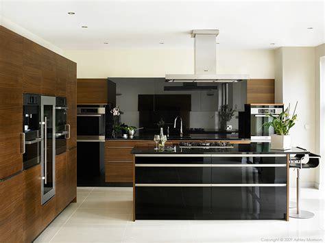 walnut kitchen designs black gloss and walnut kitchen by robinson interiors in a