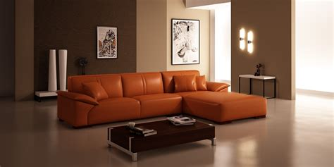 contemporary living room design with grey faux leather dark brown short sectional sofa combined green wall paint