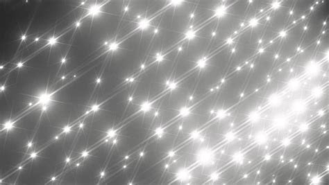 flashing silver lights in eyes moving gloss particles on silver background flood lights