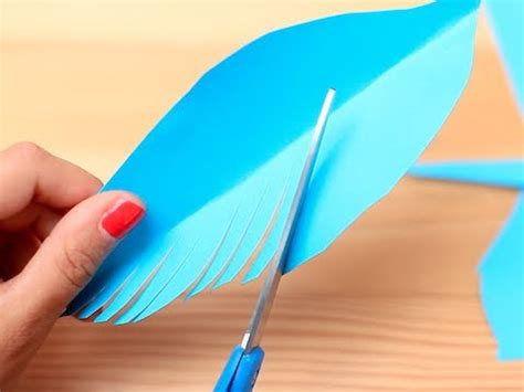 How To Make A Paper Feather - gift wrapping idea paper feathers