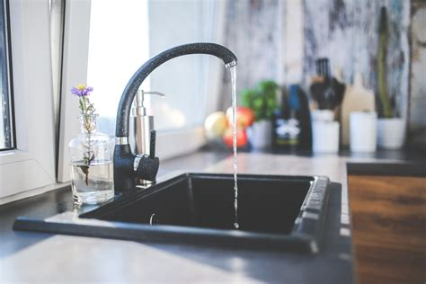 water flows from the tap to sink 183 free stock photo