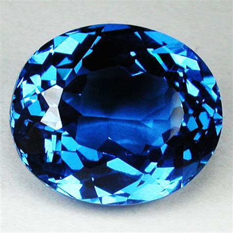 Quartz 12 81 Cts 12 65 cts beautiful blue swiss blue topaz oval
