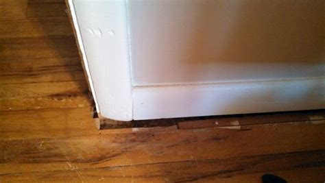 how to fill gap between cabinet and floor how to handle gaps between floor and wall trim