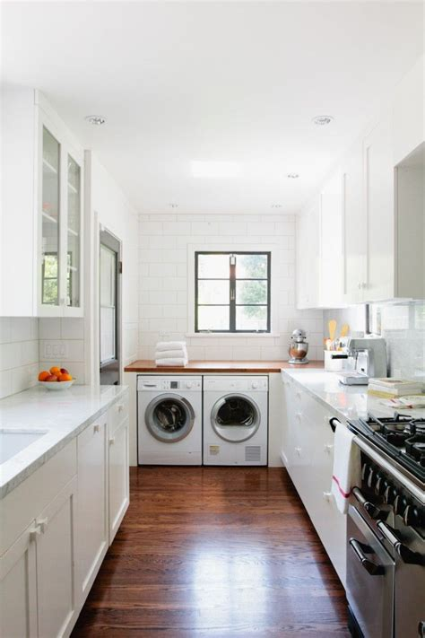 laundry room in kitchen ideas a new kitchen by way of la small white kitchens kitchens and laundry