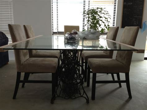 Diy dining table made from recycled glass and singer sewing table legs