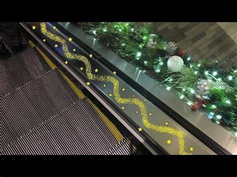 schindler single file escalators  christmas decorations  galleria mall  houston tx