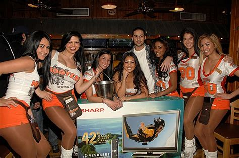 hooters girl golf swing hooters is changing their uniforms to be more family