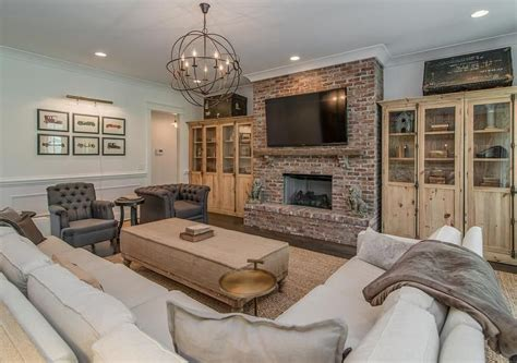 beautiful living room features a red brick fireplace