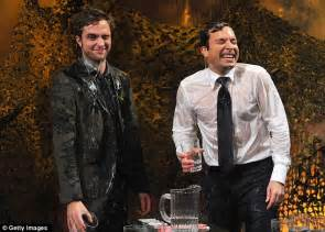 robert pattinson gets an absolute soaking during absurd