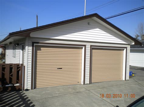 top residential garage door with residential roll up