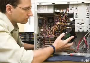 Computer Repair Tech by Image Gallery Hardware Technician