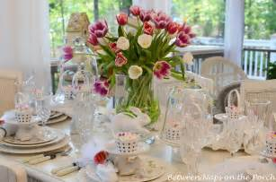 easter table spring setting with tulip centerpiece and pottery barn bunny cup cake stands