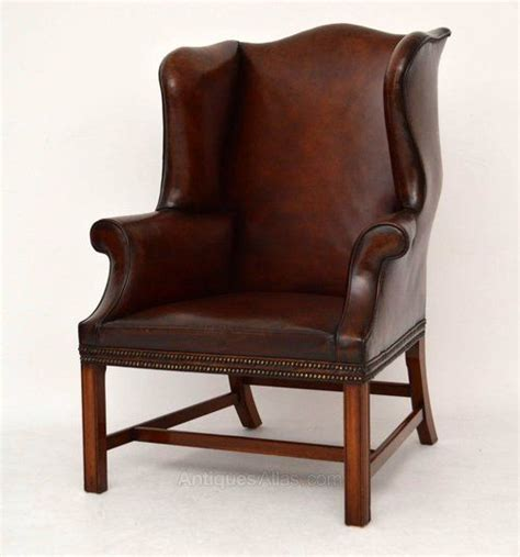 pair of antique distressed leather wing armchairs