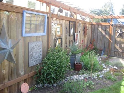 Decorating A Fence For - empty picture frames hanging on fence picket fence
