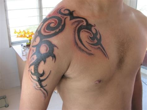 tribal tattoo on chest and shoulder 69 traditional tribal shoulder tattoos