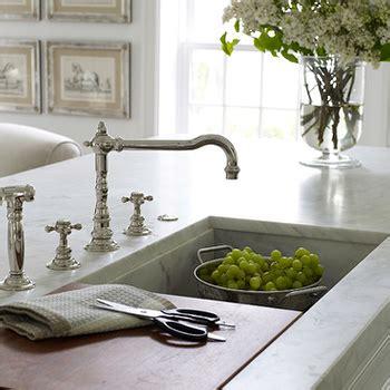 kitchen island sink with sliding cutting board