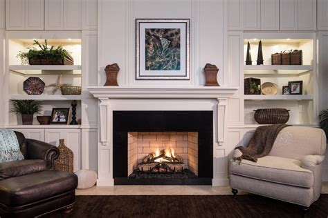 Decorating ideas for bookcases by fireplace living room beach style with painted bookshelves