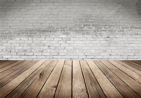Floor Palns by Wood Table With White Brick Wall Background Stock Photo