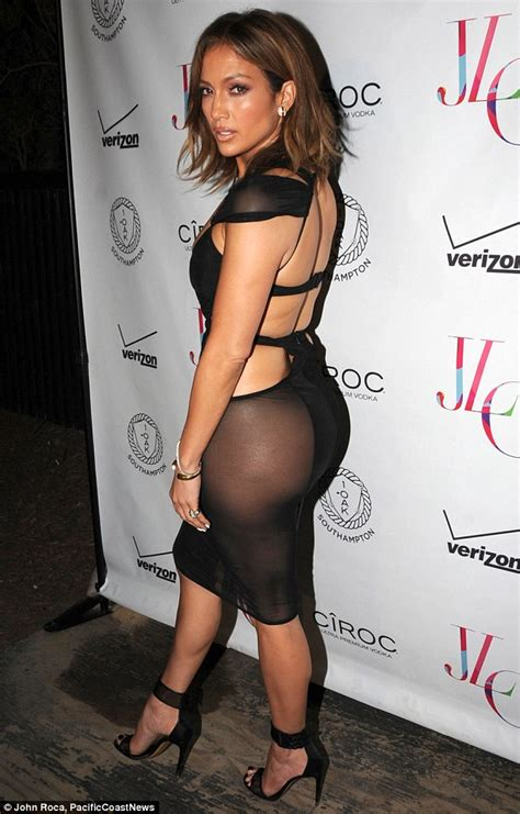 j lo la nights comforter jennifer lopez shows cleavage in see through dress on her
