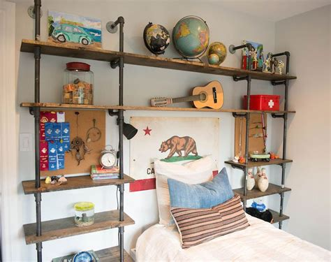 shelves for boys bedroom eclectic boy s bedroom features an industrial pipe and wood shelving unit which frames