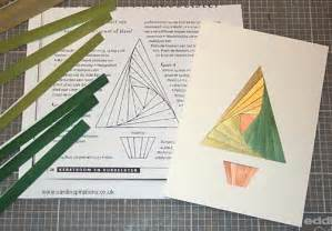 From left to right folded strips of coloured paper iris folding