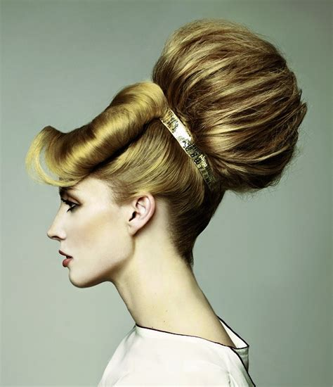 hairstyles with bangs tied up amazing hairstyle with big bun tied with a band and side