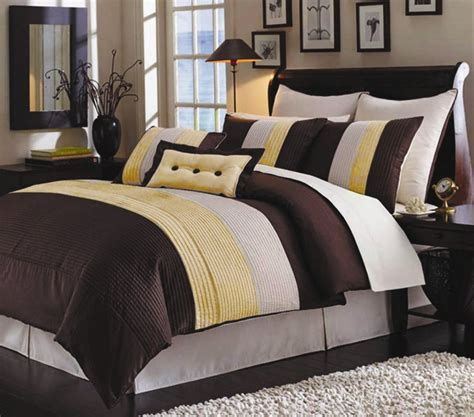 yellow and brown bedding casual look bedroom with stripe