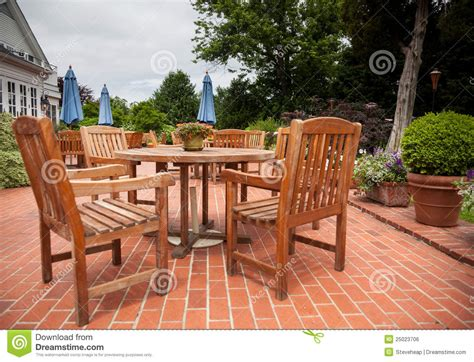 teak patio tables and chairs on brick deck stock photo image 25023706