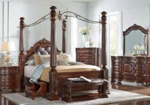 rooms to go king bedroom sets southton walnut 4 pc king canopy bed beds wood