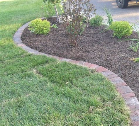 brick patio edging 25 best ideas about paver edging on grass edging grass mower and lawn edging stones