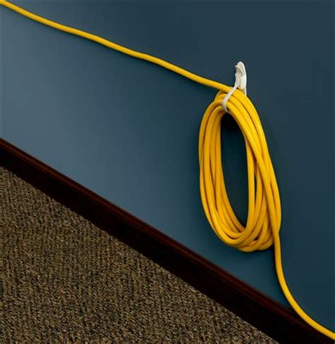 hide cords    easy hacks hellogiggles
